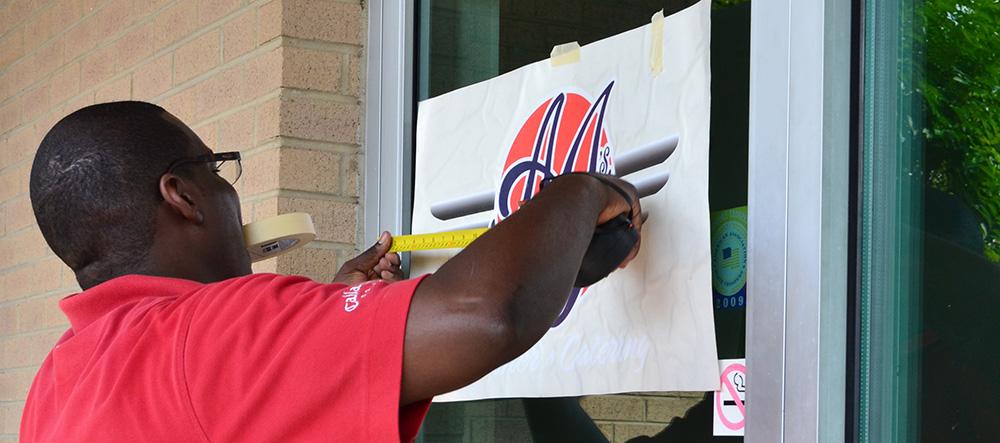 Brian Installing AJ's Door Sign